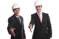 Business team, offering to shake hands. Isolated in white background royalty free stock photography