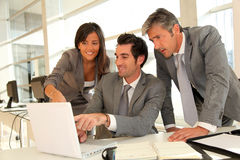 Business team in office. Sales team having business presentation in office Stock Image