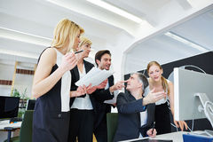 Business team in office with broken Royalty Free Stock Image
