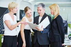 Business team in office doing planning with files Stock Photos