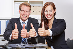 Business team in office holding Stock Photography