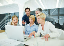 Business team in office with laptop computer Royalty Free Stock Images