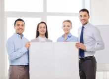 Business team in office with white blank board. Business and office concept - happy business team in office with white blank board Stock Photography