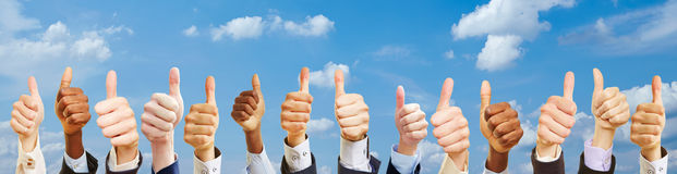 Business team outside with thumbs up Stock Images