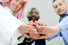 Business team overlapping hands Royalty Free Stock Image