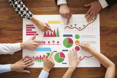 Business team. Business people analyzing many charts Stock Image