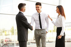 Business Team. People shake hands communicating with each other Stock Photos