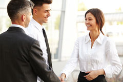 Business Team. People shake hands communicating with each other Stock Images