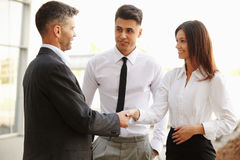 Business Team.  People shake hands communicating with each other Royalty Free Stock Photo