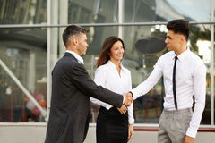 Business Team.  People shake hands communicating with each other Stock Photography