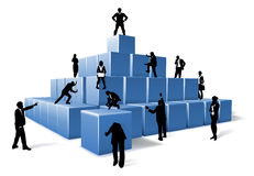 Business Team People Silhouettes Building Blocks. A business team of people silhouettes working together using big building blocks to make a structure. Concept Royalty Free Stock Photo