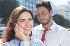 Business team with phone in the city Royalty Free Stock Photography