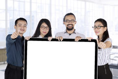 Business team with placard and OK sign Stock Photography