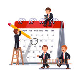 Business team planning together on a big calendar Stock Photo