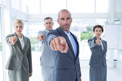 Business team pointing at the camera Royalty Free Stock Photos