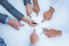 Business team pointing clipboard Royalty Free Stock Images