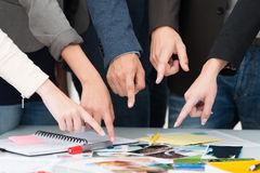 Business team pointing to a universal choice Royalty Free Stock Photo