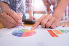 Business team pointing the turnover graph chart while discussion Royalty Free Stock Photo