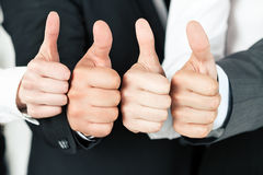 Business team pointing up their thumbs stock photography