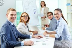 Business team portrait. Cheerful team members looking at camera and smiling Stock Images