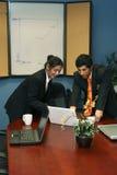 Business Team Preparing for Presentation Stock Photos