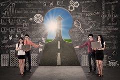 Business team present marketing road success concept. Business team present marketing road success through a key hole Stock Image