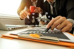 Two business meeting professional investor working together. Business team present. professional investor working new start up project. .Digital tablet laptop royalty free stock photo