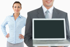 Business team presenting laptop Stock Photography