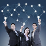 Business team pressing a Social Network button Royalty Free Stock Images