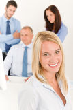 Business team pretty businesswoman with colleagues Stock Photography