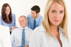 Business team pretty businesswoman with colleagues Stock Images
