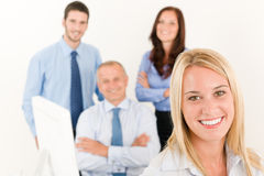 Business team pretty businesswoman with colleagues Stock Photos