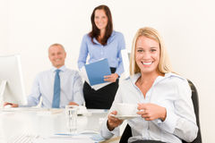 Business team pretty businesswoman drink coffee Royalty Free Stock Image