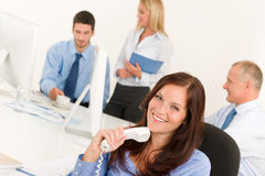 Business team pretty businesswoman holding phone Stock Images