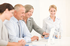 Business team pretty businesswomen with colleagues Royalty Free Stock Photo