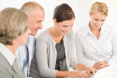 Business team pretty businesswomen with colleagues Royalty Free Stock Image