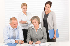 Business team pretty businesswomen with colleagues Royalty Free Stock Images
