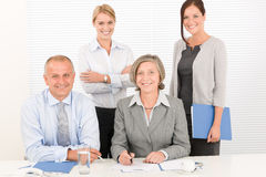 Business team pretty businesswomen with colleagues Stock Photo