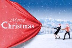 Business team pull christmas banner. Asian business team pull christmas banner stock photos