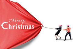 Business team pull christmas banner Stock Image