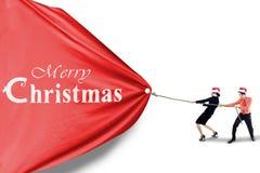 Business team pull christmas banner. Asian business team pull christmas banner stock image