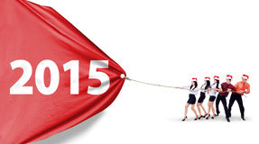Business team pulling banner new year Royalty Free Stock Image