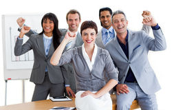Business team punching the air in celebration. Successful business team punching the air in celebration in a meeting Stock Image