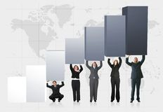 Business team pushing graph up Royalty Free Stock Photography