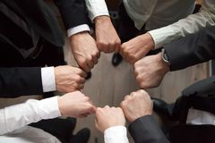Free Business Team Put Fists In Circle, Unity Concept, Top View Royalty Free Stock Photography - 116422527