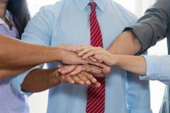 Business team put hands together Stock Images