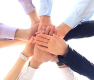 business team putting hands on top of each other Royalty Free Stock Images