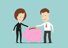 Business team putting money in piggy bank Royalty Free Stock Photography