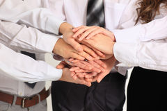 Business team putting their hands Stock Images