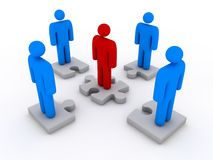 Business team and puzzle. Team with leader standing on jigsaw pieces Royalty Free Stock Images